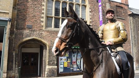 Tim FitzHigham as King Henry on horseback arrives at the Guildhall at King's Lynn as part of the Sha