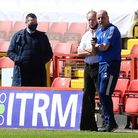 Marcus Evans talks to Paul Cook before kick-off at Charlton Athletic