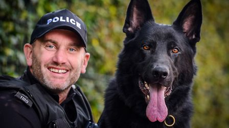PC Jim Wells with Shuck the police dog. Picture: Matthew Usher.