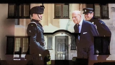 Photographic memories of the late Prince Philip are being projected onto a home in Barton Road, Ely until Sunday, April 25.