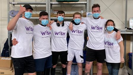 Six members of staff from Newmarket Tesco's raised money for the stroke ward that looked after their colleague.