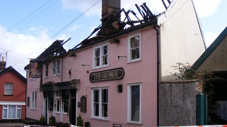 A pub with a roof which has been destroyed by fire