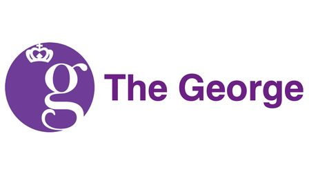 A purple circle with a g and a crown in and the words The George next to it
