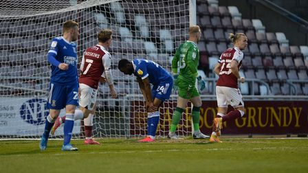 Kane Vincent-Young is disappointed to have a second half chance saved against Northampton Town