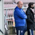 Paul Cook watching the warm up before the match against Northampton Town