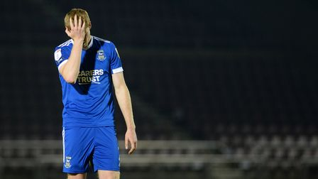 Mark McGuinness holds his head on the final whistle at Northampton Town as Ipswich lose 3-0.
