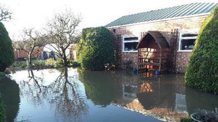 Flooded garden in Upwell Road, March