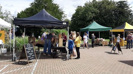 A Lavenham Farmers' Market held outside last year. This weekend's event will also be outside
