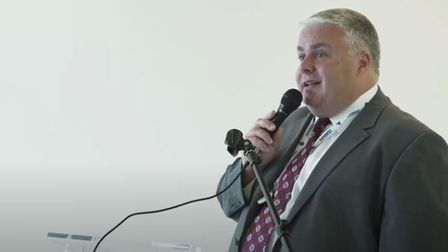 Convicted con man Stephen Day addressing the public meeting of the East of England Ambulance Service Trust as FD in 2013