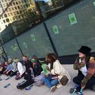 Sit-down protest waiting to be arrested... women demonstrating outside HSBC bank HQ in Canary Wharf