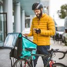 Food delivery service, rider delivering food to clints with bicycle - Concepts about transportation,