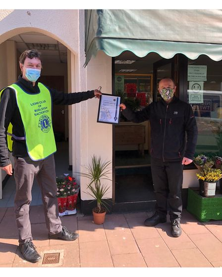 Richard Allen presenting a certificate to High Street Greengrocers