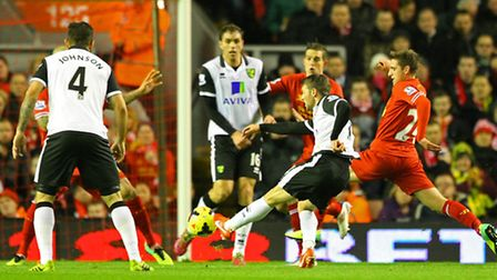 Wes Hoolahan has a shot during Norwich City's last trip to Anfield.