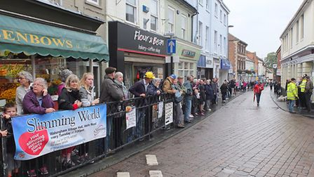 Crowds line the streets before the start. Picture: Chris Bishop