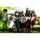 Children set off to work around the farm at a Kentwell Hall Tudor weekend event in 2003