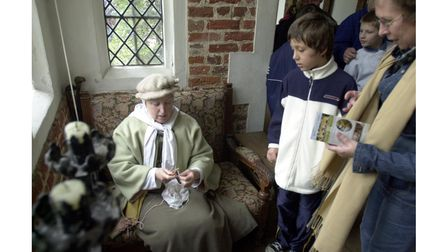 A demonstration ofTudor-style chores at Kentwell Hall in 2005
