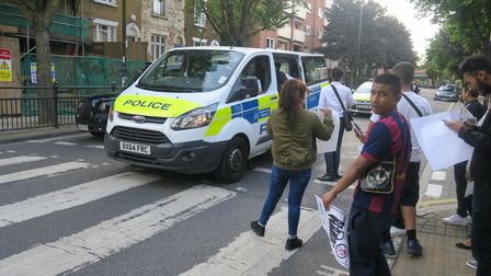 Teenagers protest atGlobe Road in Stepney Green in 2016 over their youth club closing