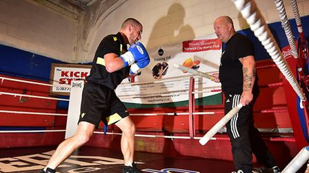 Boxer Ryan Walsh at the Kickstop Gym in Norwich., training with Graham Everett. Picture: ANTONY KELL