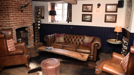 Comfy seats by a brick fireplace in The Bull Troston Suffolk