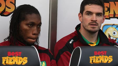 Dieumerci Mbokani, left, and Kyle Lafferty watch on from the substitutes bench during Norwich City's