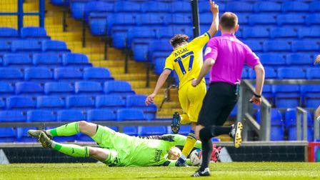 Ipswich keeper David Cornell with an early second half save at the feet of Ayoub Assal.