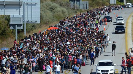 Hundreds of migrants march down a highway towards Turkeyís western border with Greece and Bulgaria.