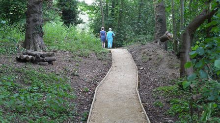 A nature path with two people walking in Woodbridge