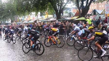 The Tour of Britain cyclists make their way past Norwich Market. Picture: DENISE BRADLEY
