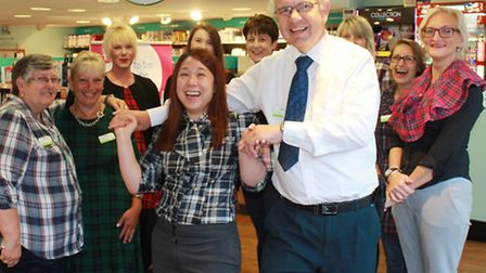 Tartan-wearing Lloyds staff look on as Scott Murray gives a demonstration of the Scottish country da