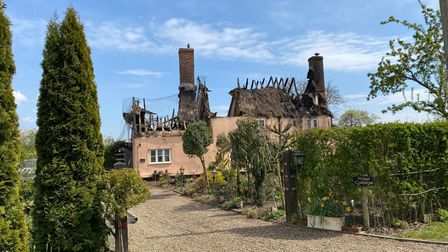 The house'ssupport beams were left exposed after the thatch roof fire on Monday
