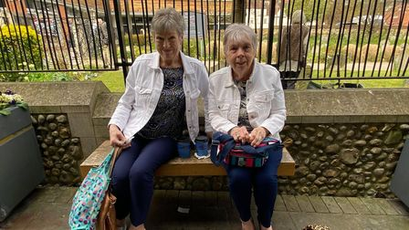 Anne and Sheila sit near Norwich's Chantry Place