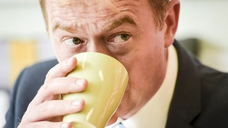 Leader of the Liberal Democrats, Tim Farron, drinks a cup of tea during his visit to the Shelter hou