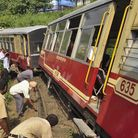 Indian police and volunteers inspect the site of the train derailment in Himachal Pradesh state, Ind