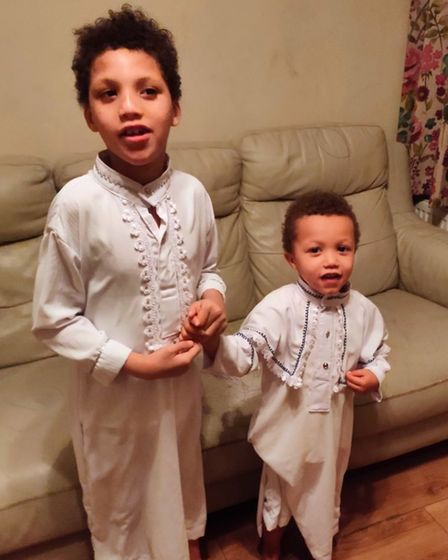 Moses, 7, with his brother, 3.