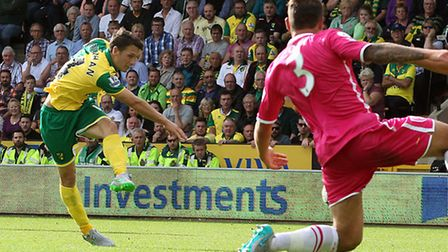 Wes Hoolahan fires Norwich City into a two-goal lead over Bournemouth at Carrow Road. Picture by Pau