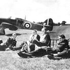 Battle of Britain pilots next to an airplane