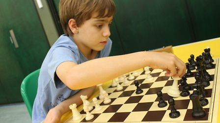 NIne-year-old Benedict Ward, of Norwich, prepares to put his opponent in checkmate at junior chess t