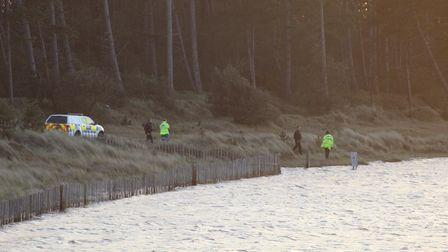 Emergency services were called out to a woman who was stranded at Holkham Beach on Wednesday evening