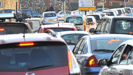 Traffic queuing for city centre car parks brings Norwich to a halt as the queues block passage for o