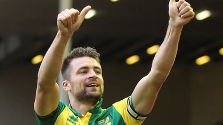 Russell Martin salutes the Norwich City fans at Anfield. Picture: Paul Chesterton/Focus Images Ltd