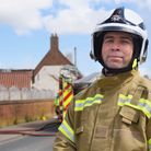 Assistant chief at Norfolk Fire Service, Scott Norman, at the scene of the fire of a thatched house