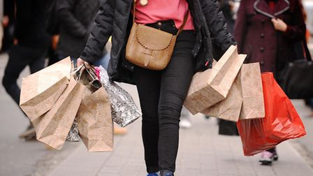 File photo dated 6/12/11 of a shopper carrying shopping Picture: Dominic Lipinski/PA Wire