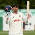 Sir Alastair Cook of Essex celebrates scoring a century of runs against Worcestershire at New Road