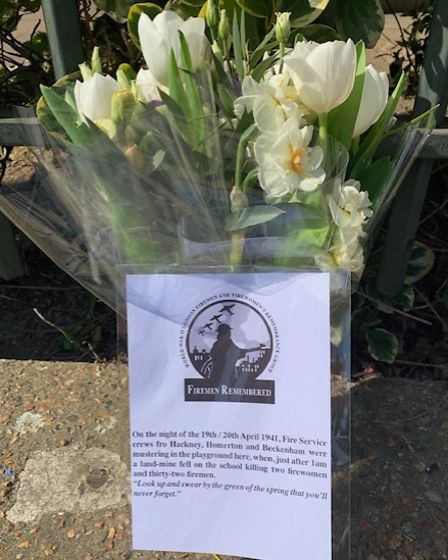 Flowers at Old Palace School on 80th anniversary of 32 firemen and 2 women killed onApril 20, 1940