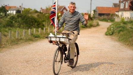 Felixstowe Harbour Master John White cycling to a street party on the day of the royal wedding 2011.