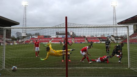 Doncaster Rovers' Fejiri Okenabirhie (right) celebrates scoring his side's second goal of the game d