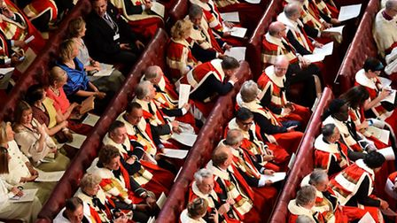 Peers and guests sit in the House of the Lords as Britain's Queen Elizabeth II arrives to deliver th