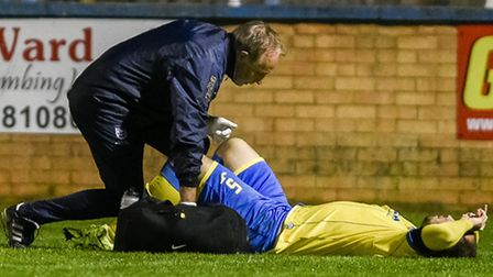 Action from King's Lynn Town v Histon at The Walks - Lynn's Sam Gaughran goes off injured. Picture: