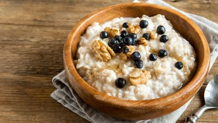 A warm breakfast like porridge - with optional nuts and berries - will give you a great start to the