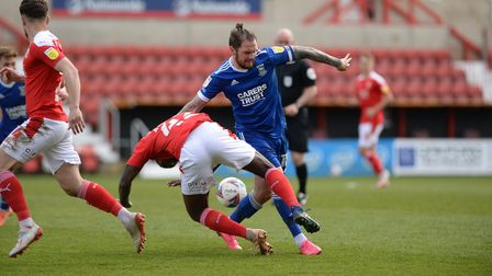 James Norwood shields the ball at Swindon Town
